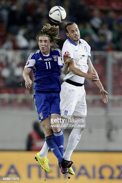Greece's Vangelis Moras fights for the ball with Faroe Island's Joan Edmundsson during the UEFA Euro 2016 group F qualifying football match between...