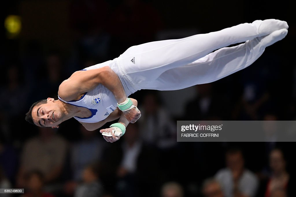 Greeces Vlasios Maras performs during the Mens Horizontal Bar competition of the European Artistic Gymnastics Championships 2016 in Bern, Switzerland on May 29, 2016. / AFP / FABRICE