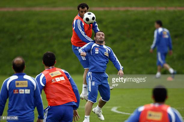 Greece's Yiannis Goumas and Dimitris Salpigidis fight for the ball during a training session in Seekirchen sports center on June 5 2008 Greece will...