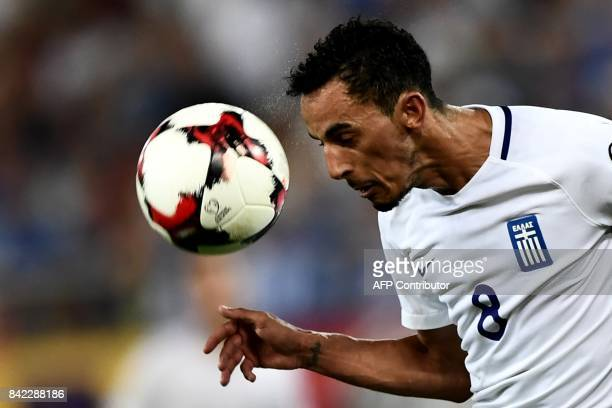 Greece's Zeca heads the ball during the 2018 FIFA World Cup qualifying football match between Greece and Belgium at Georgios Karaiskakis Stadium in...