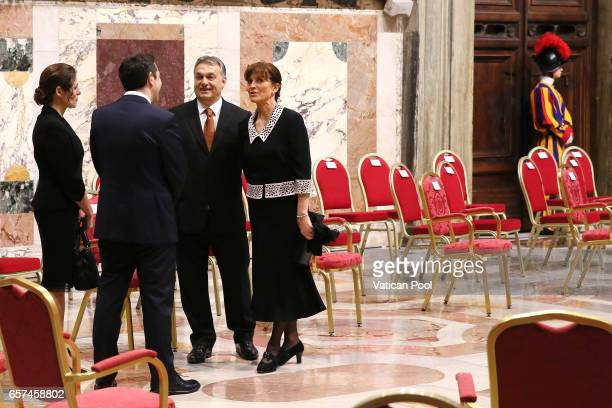 Greec's Prime Minister Alexis Tsipras flanked by his wife chats with Prime Minister of Hungary Viktor Orban and wife before a meeting with Pope...