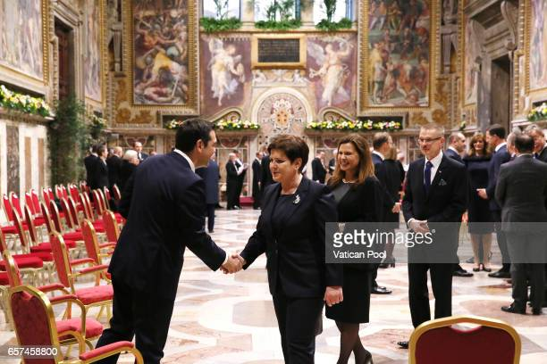 Greec's Prime Minister Alexis Tsipras greets Poland's Prime Minister Beata Szydlo before a meeting with Pope Francis at the Regia Hall on March 24...