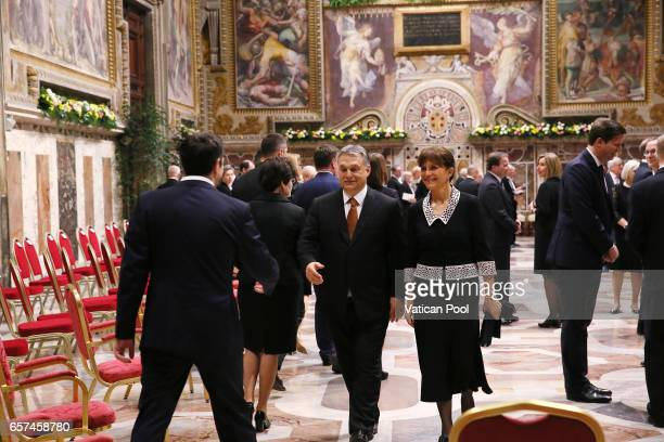 Greec's Prime Minister Alexis Tsipras greets Prime Minister of Hungary Viktor Orban and wife before a meeting with Pope Francis at the Regia Hall on...