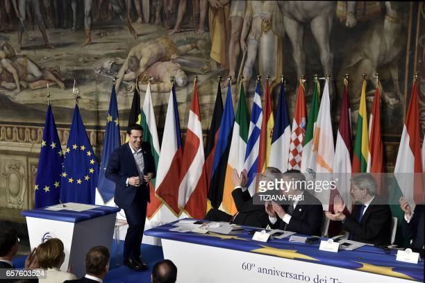 Greec's Prime Minister Alexis Tsipras is applauded after signing the new Rome declaration with leaders of 27 European Union countries special next to...