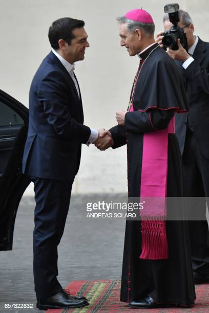 Greec's Prime Minister Alexis Tsipras is welcomed by the prefect of the papal household Georg Gaenswein as she arrives for an audience of Pope...