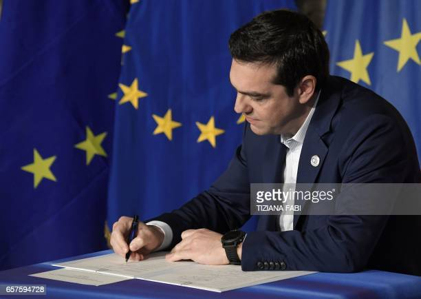 Greec's Prime Minister Alexis Tsipras signs the new Rome declaration with leaders of 27 European Union countries special during a summit of EU...