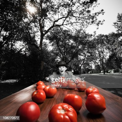 Greed, Bowler Hat, Suburbia and Tomatoes (Bizarre Portrait) : Stock Photo