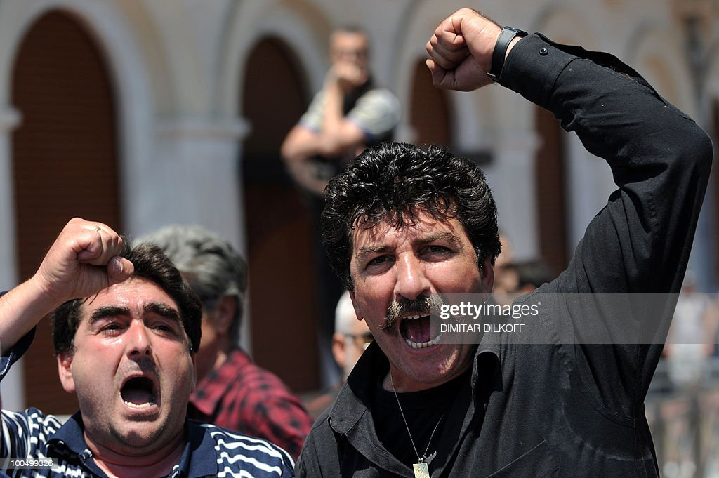 Greeek municipality workers shout anti-government slogans during their strike in central Athens on May 3, 2010. The Greek press warned that the country faced a new era of painful sacrifices a day after the government unveiled deep austerity cuts in return for EU and IMF loans.