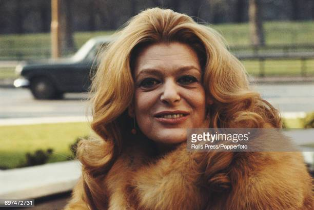 Greek actress Melina Mercouri pictured posed wearing a fur coat on Park Lane London in March 1971