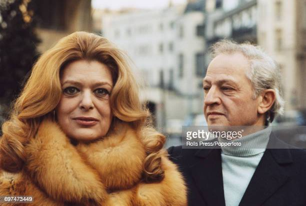 Greek actress Melina Mercouri pictured posed wearing a fur coat with her husband American film director and actor Jules Dassin in London in March 1971