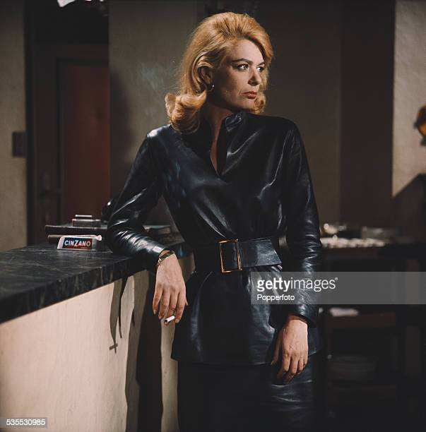 Greek actress Melina Mercouri pictured wearing a leather belted top and skirt in character as Magda on the set of the film The Victors in 1962