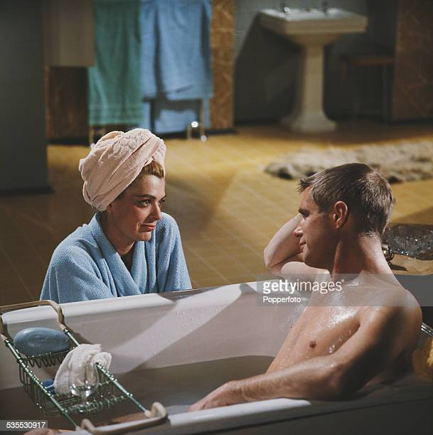 Greek actress Melina Mercouri pictured with actor George Peppard lying in a bath tub on the set of the film 'The Victors' in 1962