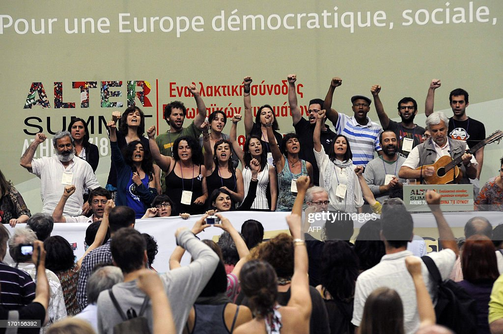 Greek and foreign participants of the Athens Alter summit join their voices during a plenary and presentation of the manifesto late on June 7, 2013. More than 300 European movements, organisations and unions will join forces in a march against austerity, poverty and racism in Athens on June 8, 20123 as part of the ongoing Alter Summit.