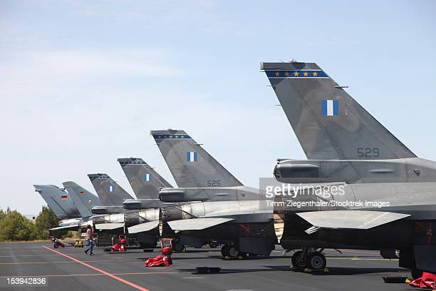 Greek and German fighter planes side by side at Albacete Airfield, Spain, during the Tactical Leadership Program exercise.