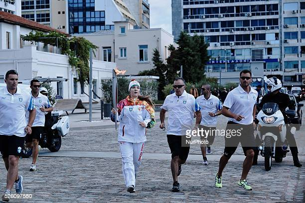 Greek athlete of skiing Anastasia Gogou carries the Olympic Flame The Olympic Flame of the SOCHI 2014 winter olympics arrived today morning in...