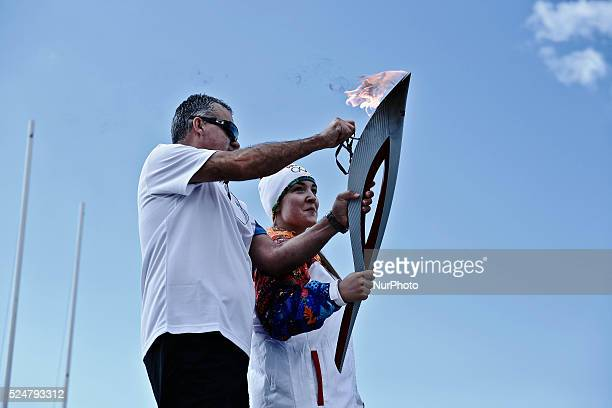 Greek athlete of skiing Anastasia Gogou holds the Olympic Flame The Olympic Flame of the SOCHI 2014 winter olympics arrived today morning in...