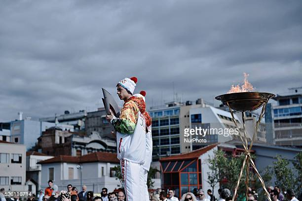 Greek athletes standing in front of the Olympic Flame of SOCHI 2014 The Olympic Flame of the SOCHI 2014 winter olympics arrived today morning in...