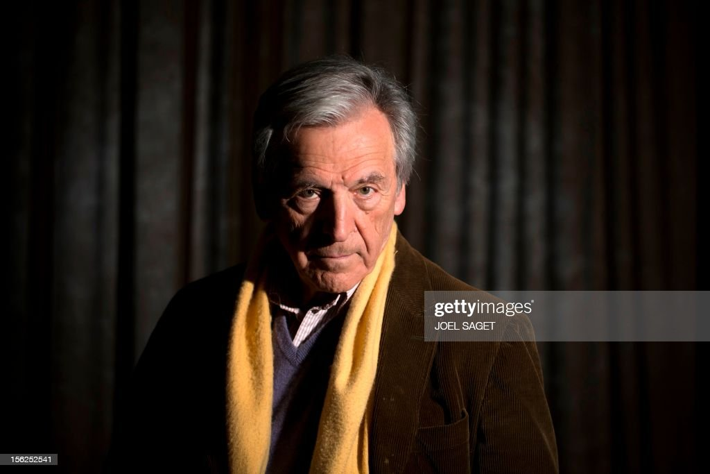 Greek born French director Costa Gavras poses on November 12, 2012 as part of the presentation of his latest film 'Le Capital' at the Fouquet's Barriere Hotel in Paris.