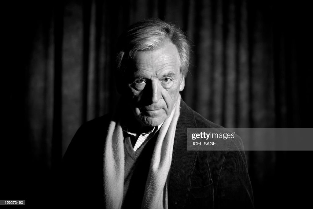 VERSION - Greek born French director Costa Gavras poses on November 12, 2012 during the presentation of his latest film 'Le Capital' at the Fouquet's Barriere Hotel in Paris. AFP PHOTO / JOEL SAGET
