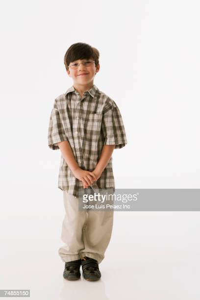 Greek boy with hands clasped