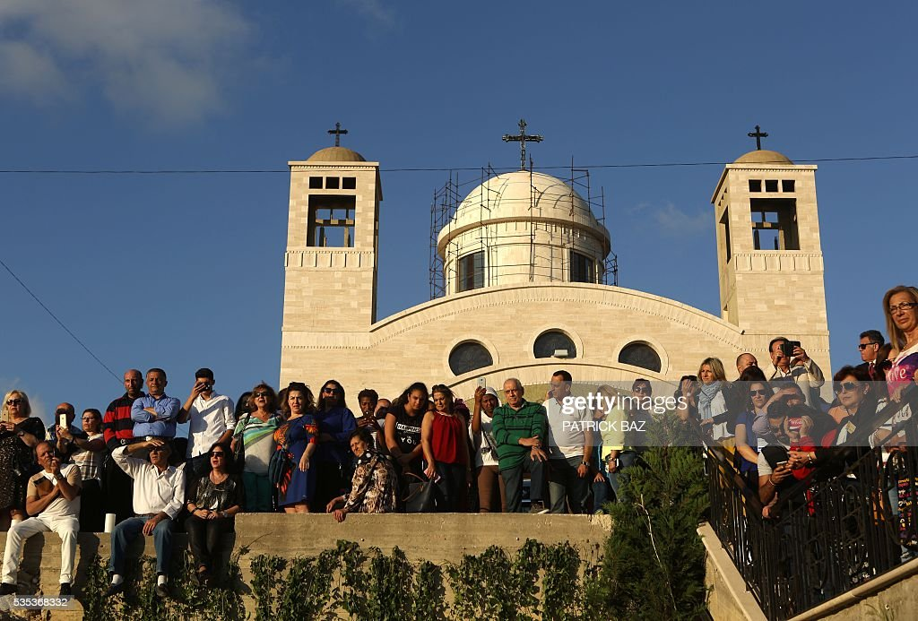 Greek Catholic Christians, also known as Melkite, gather at the Basilica of Our Lady of Mantara in the southern Lebanese town of Maghdouche East of Sidon, on May 29, 2016, during the launching of an event by the Ministry of Tourism to put the Grotto of Maghdouche on the international religious tourism map. Magdouche, along with Lourdes in France, Fatima in Portugal and Medugorje in Bosnia & Herzegovina are expected to be put on the international religious tourism map. According to local tradition the Virgin Mary accompanied Jesus during his journey to Tyre and to Sidon and waited for him in the grotto at Magdoucheh. The grotto was discovered 400 years ago. / AFP / Patrick BAZ