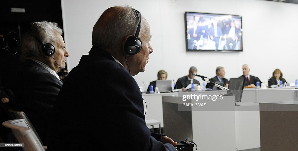 Greek chief engineer Nikolaos Argyropoulos (L) and Apostolos Mangouras, Greek captain of the petrol tanker Prestige, attend the third day of their trial over the sinking of the Prestige, the worst oil spill in spain's history, in Coruna, on November 13, 2012. Ten years after the sinking of the Prestige oil tanker off Spain, the ship's Greek captain and three others went on trial over the worst oil spill in the country's history. Prosecutors are demanding 12 years in jail for Mangouras, who is charged with harming the environment along with Greek chief engineer Nikolaos Argyropoulos and first mate Irineo Maloto, a Filipino whose whereabouts are unknown.
