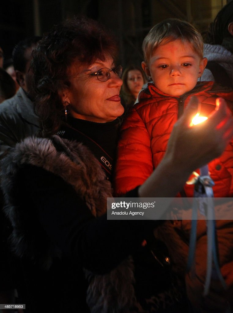 Greek Christians hold candles during the Easter Celebration ceremony on April 20, 2014 in Athens, Greece. Christians around the world celebrate Easter, the day they believe Jesus was resurrected from the dead.