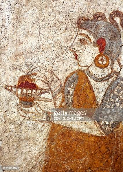 Greek civilization 16th century bC Fresco depicting a priestess burning incense From Akrotiri Thera Island Santorini Greece Detail a coastal town
