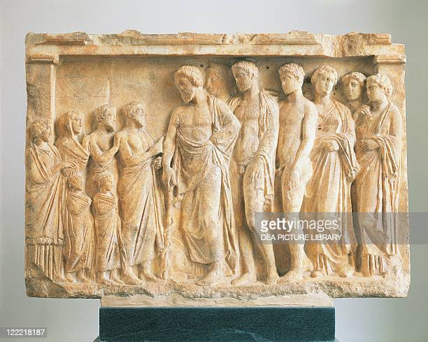 Greek civilization 4th century bC God Asclepius accompanied by his children before a family of devotees Votive marble relief