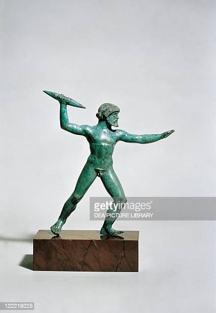 Greek civilization 5th century bC Bronze statue of Zeus scaling a bolt of lightening From Dodona Greece