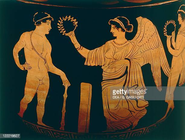 Greek civilization 5th century bC Redfigure pottery Detail of a vase victory crowns an athlete with an olive branch