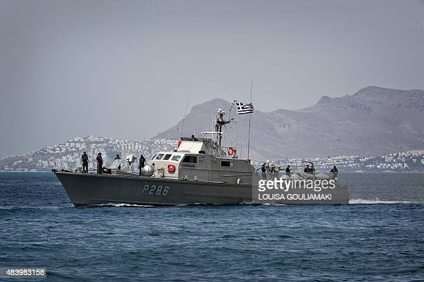 A Greek coast guard vessel returns after patrol to the port of Kos island with the Turkish coast in the background on August 14 2015 Turkish efforts...