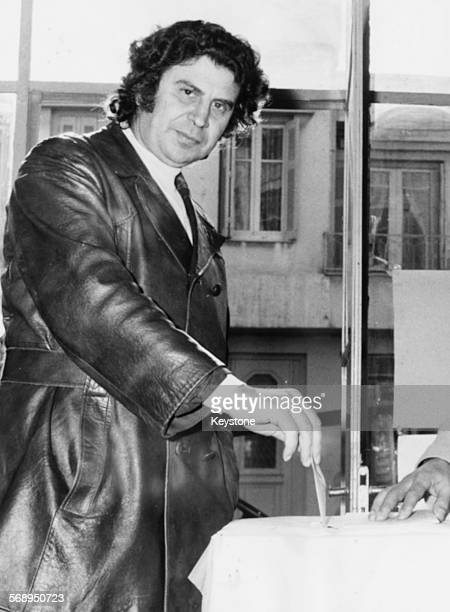Greek composer and musician Mikis Theodorakis posting his vote for the United Left in the ballot box during the Greek elections November 19th 1974