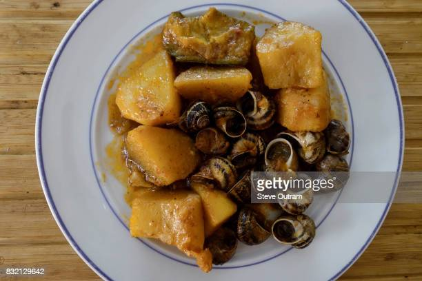 Greek Cuisine. Cooked Snails with Roast Potatoes, Cretan Style.
