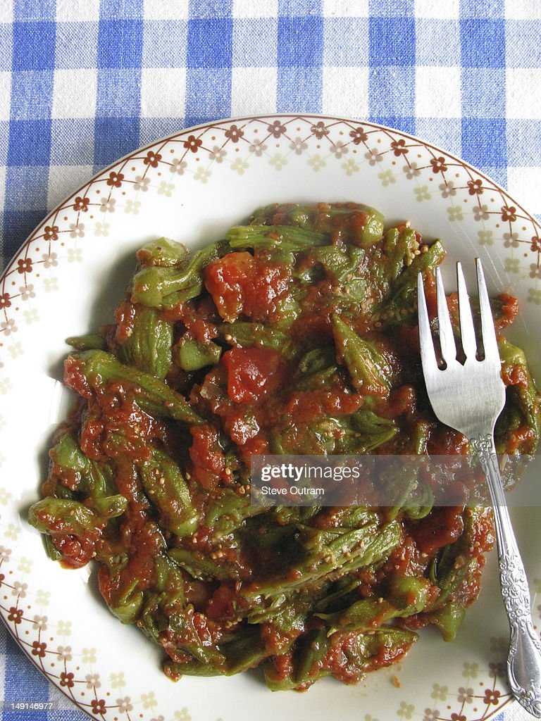 Greek cuisine; okra in tomato sauce : Stock Photo
