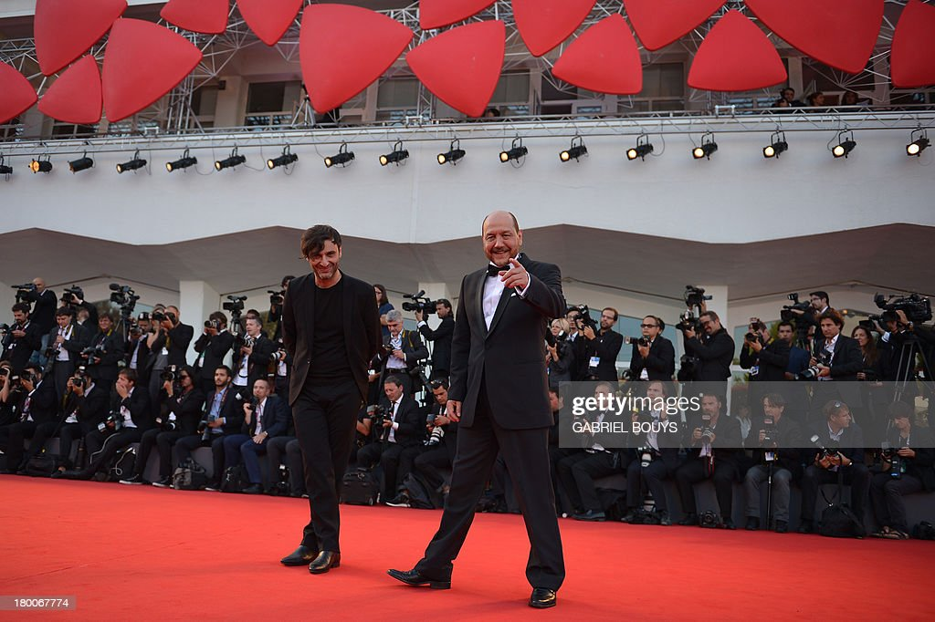 Greek director Alexandros Avranas (L) and actor Themis Panou arrive for the award ceremony of the 70th Venice Film Festival on September 7, 2013 at Venice Lido.