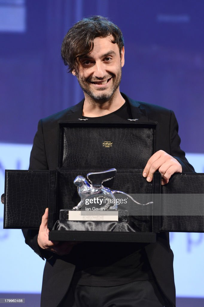 Greek director Alexandros Avranas poses with the Silver Lion for Best Director he received for his movie 'Miss Violence' on stage during the Closing Ceremony at the 70th Venice International Film Festival at the Palazzo del Casino on September 7, 2013 in Venice, Italy.