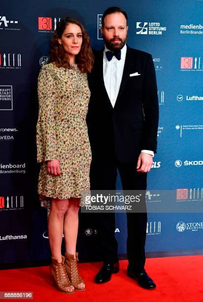 Greek director Yorgos Lanthimos and French actress Ariane Labed pose upon arrival for the 30th European Film Awards in Berlin on December 9 2017 /...