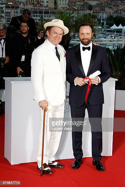 Greek director Yorgos Lanthimos poses at the photocall with John C Reilly after being awarded with the Jury prize at the 'Palm D'Or Winners'...