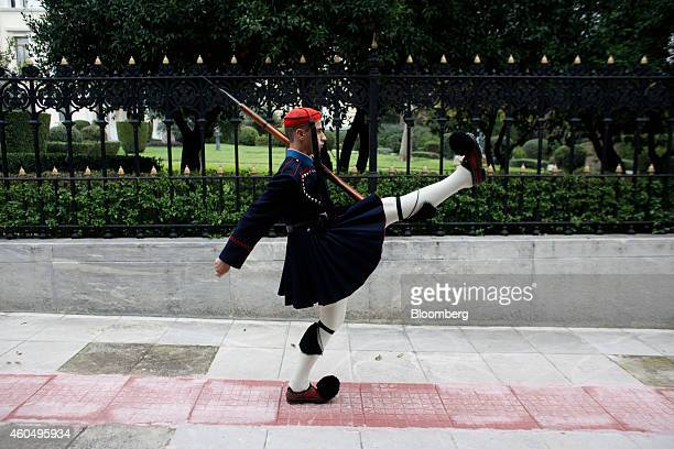 A Greek Evzones ceremonial guard high steps while marching outside the presidential palace in Athens Greece on Monday Dec 15 2014 Greece's Prime...