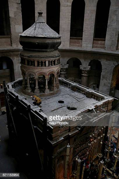 Greek experts from the University of Athens stand on top of the Tomb of Christ where according to Christian belief the body of Jesus was laid after...