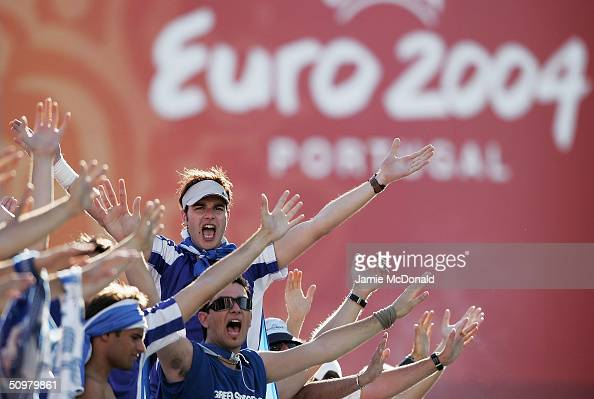 Greek fans celebrate during the UEFA Euro 2004 Group A match between Russia and Greece at the Algarve Stadium on June 20 2004 in Faro Portugal
