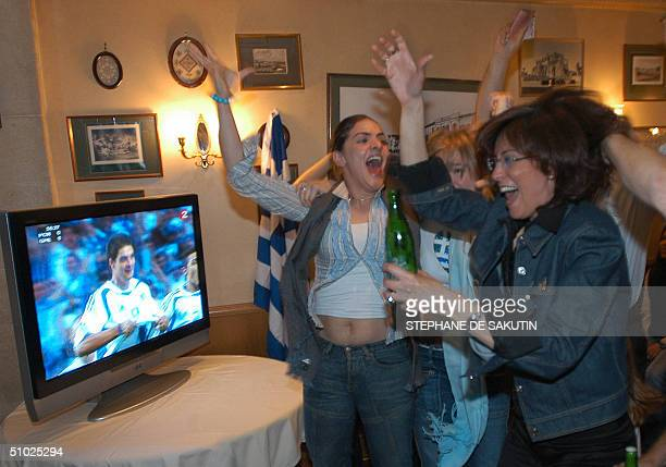 Greek fans jubilate as they watch Greece beat Portugal 10 in the Euro2004 championship final 04 July 2004 in a Greek restaurant in Paris