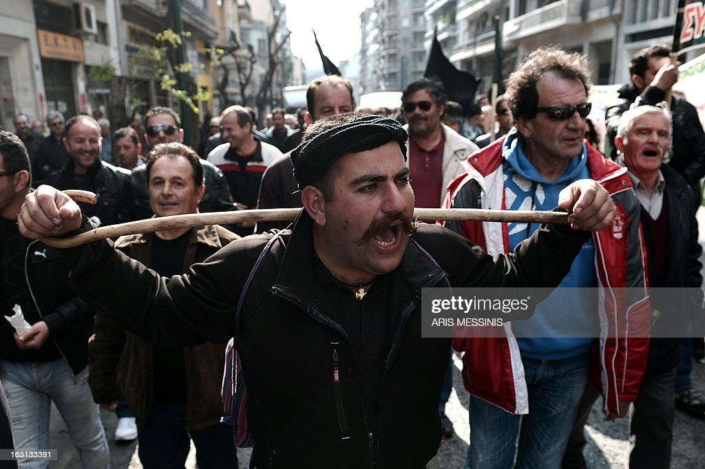 A Greek farmer shouts slogans during a demonstration in central Athens on March 5, 2013. Over 2,000 Greek farmers gathered in Athens to demand lower taxes, arguing that the rising cost of fuel and electricity was driving them to ruin.The farmers also called for subsidies from the heavily indebted state, which has been forced to undertake a tough austerity policy, to help them lower their costs and remain competitive.