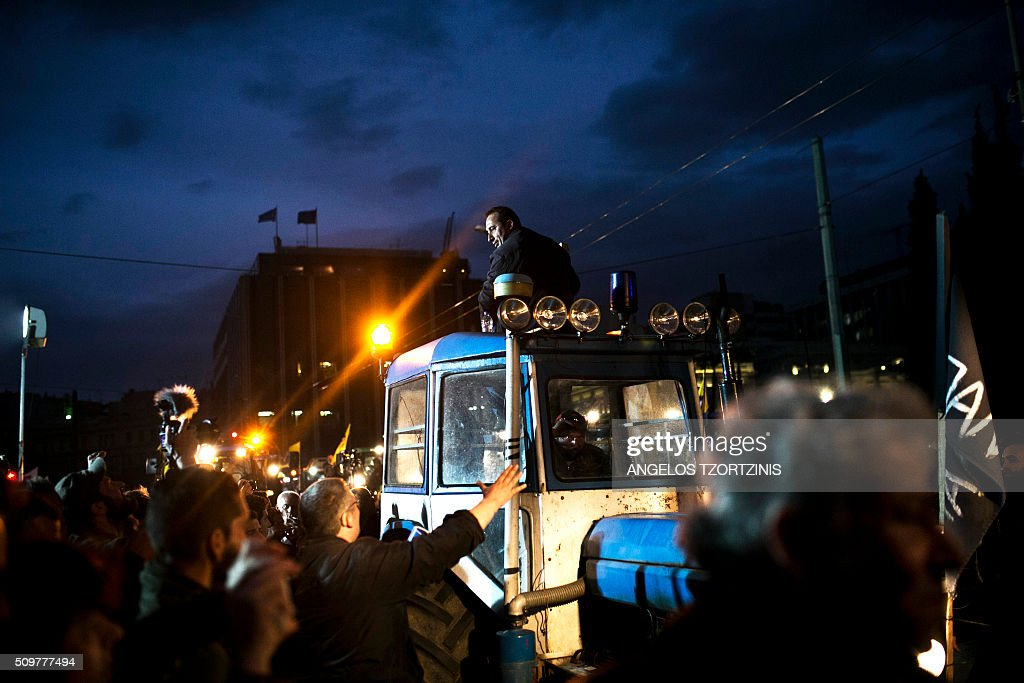 Greek farmers arrive on tractors outside the Greek parliament during a protest against pension reform and tax issues, on February 12, 2016. Fears that Greece will exit the eurozone, a 'Grexit', could revive if Greek authorities do not come up with 'credible' reforms, notably on pensions, a senior IMF official said February 11, 2016. / AFP / ANGELOS TZORTZINIS