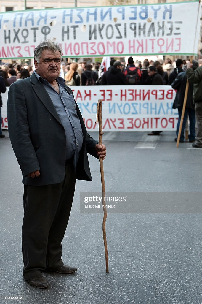 A Greek farmers attends a demonstration in central Athens on March 5, 2013. Over 2,000 Greek farmers gathered in Athens to demand lower taxes, arguing that the rising cost of fuel and electricity was driving them to ruin.The farmers also called for subsidies from the heavily indebted state, which has been forced to undertake a tough austerity policy, to help them lower their costs and remain competitive.