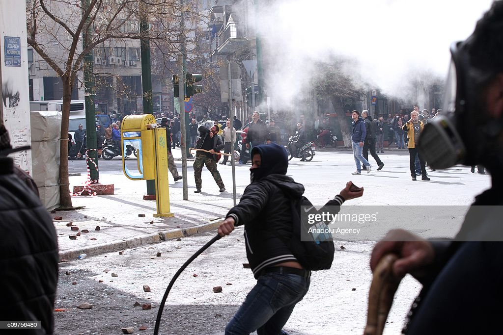 Greek farmers clash with police officers during a demonstration against pension reforms in Athens, Greece on February 12, 2016.