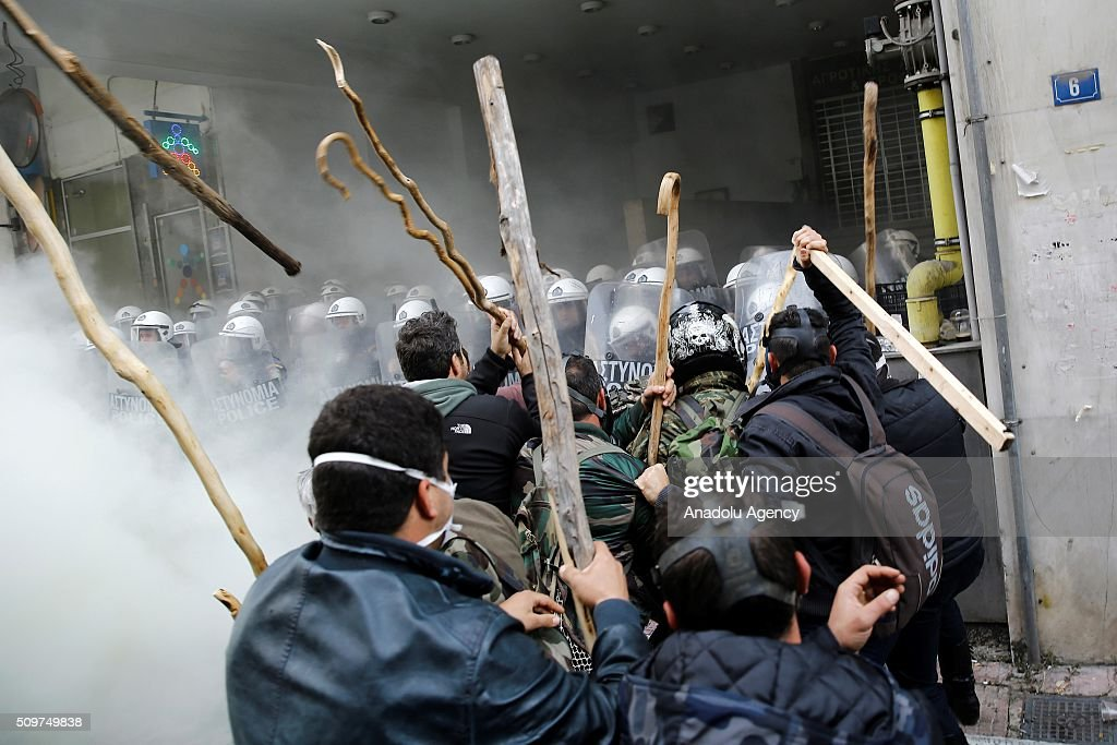 Greek farmers clash with police officers in front of the Agriculture ministry in Athens, during a demonstration against pension reform on February 12, 2016.