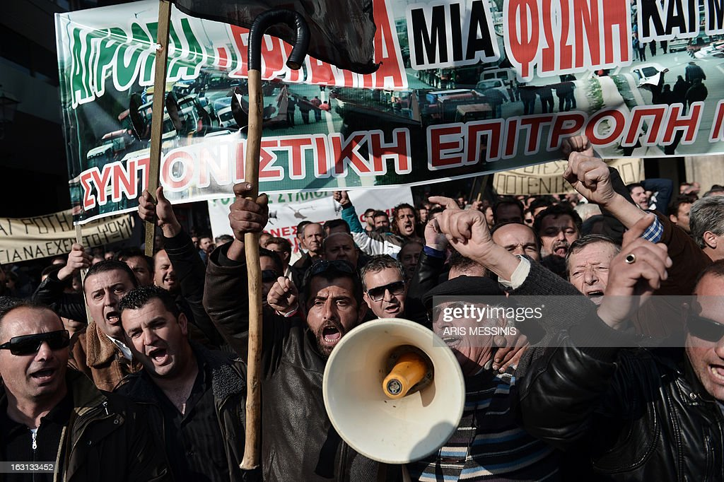 Greek farmers shout slogans during a demonstration in central Athens on March 5, 2013. Over 2,000 Greek farmers gathered in Athens to demand lower taxes, arguing that the rising cost of fuel and electricity was driving them to ruin.The farmers also called for subsidies from the heavily indebted state, which has been forced to undertake a tough austerity policy, to help them lower their costs and remain competitive.
