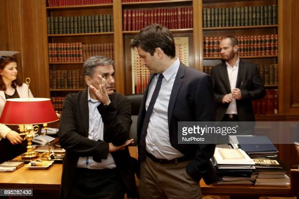 Greek Finanace Minister Euclid Tsakalotos and George Chouliarakis Alternate Finance Minister at Maximos mansion in Athens on June 12 2017